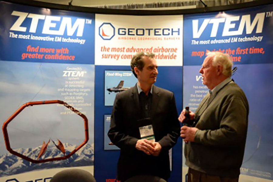 Geotech's Jean Legault in front of Geotech conference booth.