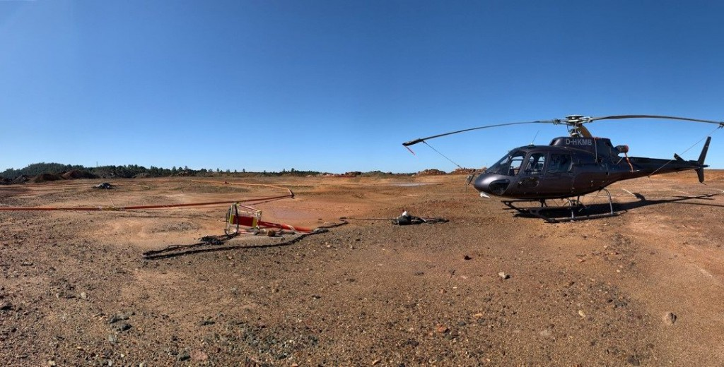 Helicopter on the ground with survey equipment