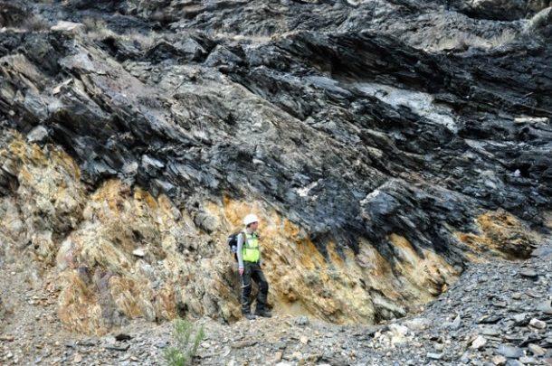 Man standing on rocky hillside